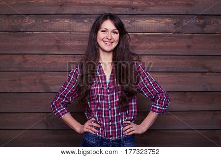 Studio portrait of pretty young female in casual clothes posing in the studio. Charming slim girl in trendy light outfit posing. Young beautiful woman with long brunette hair and perfect smile