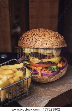 Tasty classical burger with fried potato