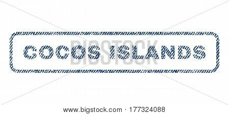 Cocos Islands text textile seal stamp watermark. Blue jeans fabric vectorized texture. Vector caption inside rounded rectangular banner. Rubber sticker with fiber textile structure.