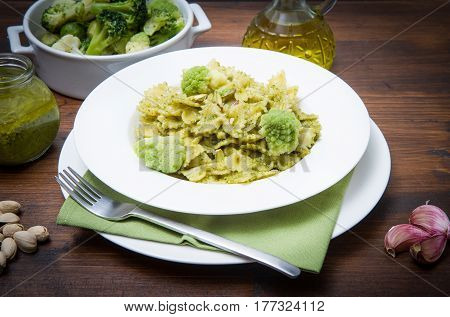 dish with pasta with broccoli pesto and pistachios