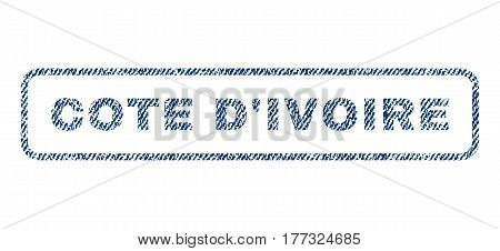 Cote D'Ivoire text textile seal stamp watermark. Blue jeans fabric vectorized texture. Vector tag inside rounded rectangular shape. Rubber sign with fiber textile structure.