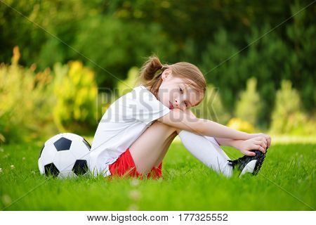 Cute Little Soccer Player Having Fun Playing A Soccer Game On Summer Day
