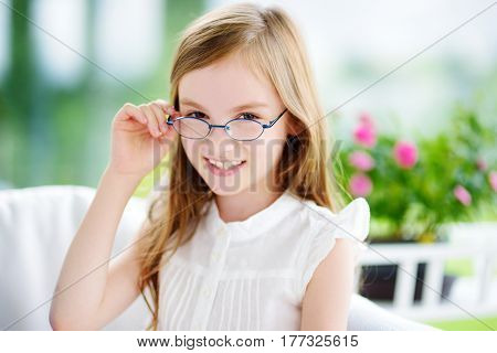 Portrait Of Cute Little Girl Wearing Glasses At Home. Vision, Health, Ophthalmology Concept.