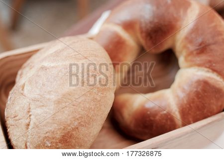 A basket of fresh artisan bread rolls