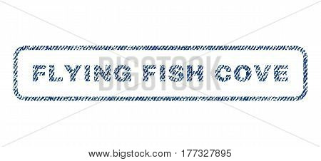Flying Fish Cove text textile seal stamp watermark. Blue jeans fabric vectorized texture. Vector tag inside rounded rectangular shape. Rubber sign with fiber textile structure.