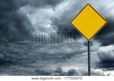 blank road warning sign in front of storm cloud background, ready for text