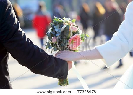 the bride and groom holding wedding bouquet