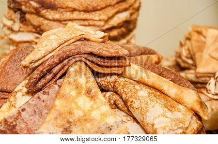 A stack of folded pancakes while celebrating Russian Shrovetide (pancake week)
