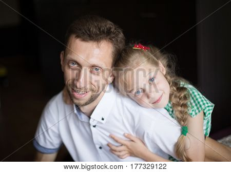 portrait of dad with his beloved little daughter on a dark background poster