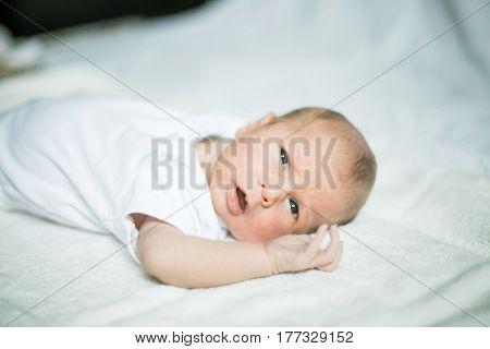 cute newborn baby waking up in the crib