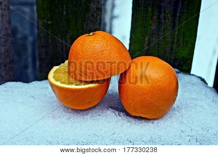 Pieces of orange in the yard in the snow