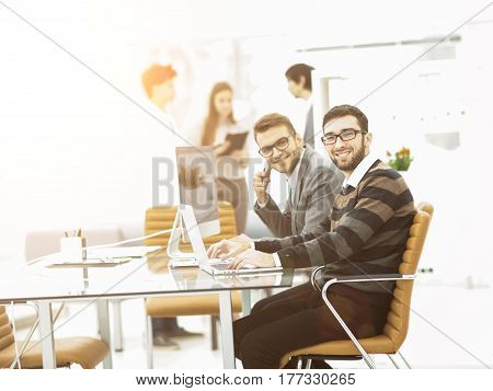 business team working on a presentation of a new advertising project.the photo has a empty space for your text