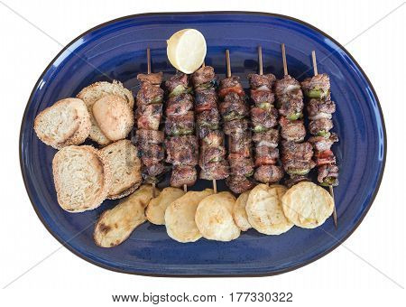 greek souvlaki and potates on the plate isolated on white background