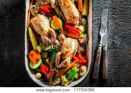 Roasted Quails With Vegetables And Spices In Casserole