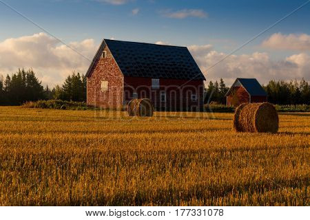 Red barn at dawn in rural Prince Edward Island, Canada.
