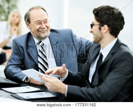 The image of business partners discussing documents and ideas in the office