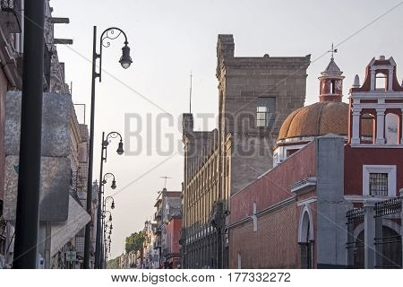 Street with Spanish colonial buildings in Puebla Mexico