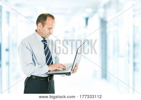 close-up of a businessman who deals on the Internet on the laptop. photo blurred background and has an empty space for your text