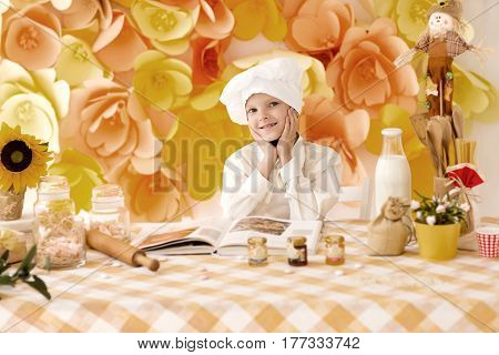 cute little baby is preparing tasty meals in the kitchen
