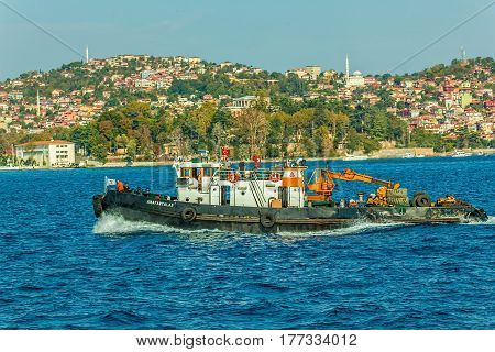 ISTANBUL, TURKEY - SEPTEMBER 29: Tugboat operating in Bosphorus between lot of Istanbul ports on September 29th, 2013 Istanbul, Turkey.