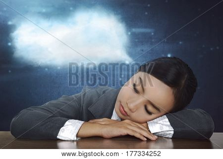 Overworked Asian Business Woman Sleeping In Desk At Work