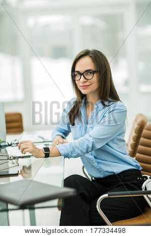 business woman at workplace in the modern office .the photo has a empty space for your text