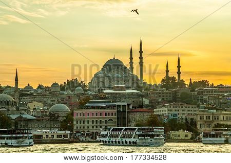 ISTANBUL, TURKEY - SEPTEMBER 28: Looking towards the Suleymaniye mosque from the Galata Bridge with passenger ships arriving to the port on September 28th, 2013 Istanbul, Turkey.