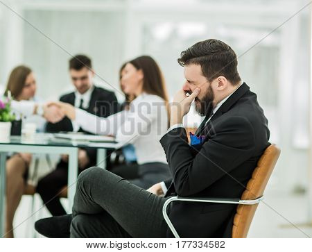 photo of the boss on the background of handshake of a Manager with a client in the workplace in a modern office.the photo has a empty space for your text