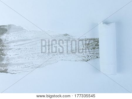A torn piece of paper on a background of a multicolored sheet of paper, perfect for your text