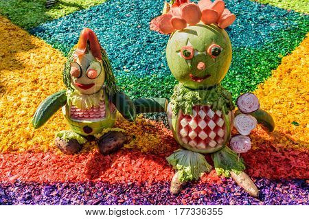 Antigua, Guatemala - March 19 2017: Close up of details made from fruit & vegetables on handmade dyed sawdust procession carpet during Lent in colonial town with most famous Holy Week celebrations in Latin America.