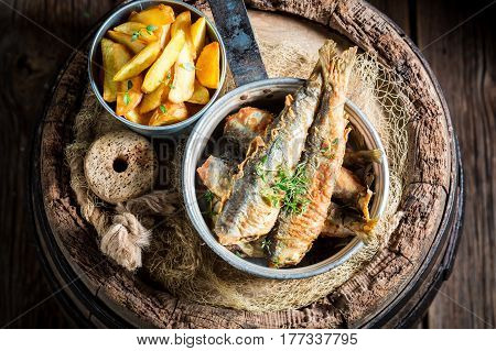 Tasty Herring Fish And Chips With Salt And Herbs