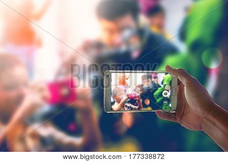 Person is taking video with a smartphone.