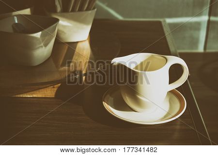 The coffee cup with the morning light in retro scene