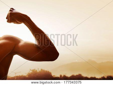 Closeup shape muscular man body on outdoor