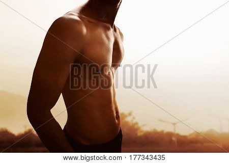 Potrait of shape muscular man body on outdoor