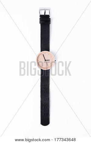 Wood wrist watch On white background Lighting in the studio