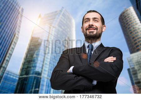 Portrait of a confident businessman in front of his office