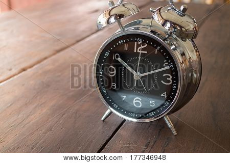 Retro Alarm Clock On Wooden Table stock photo