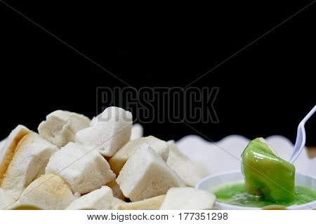 Pieces of Steamed Bread  with Green Custard Ready to Eat