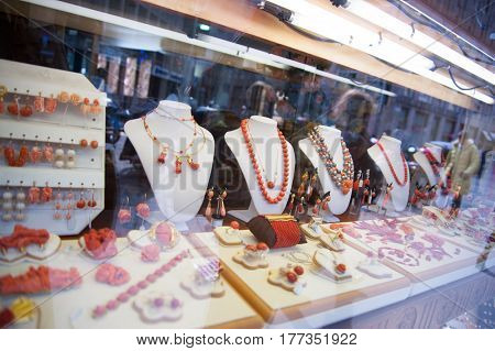 Jewelry in the window case at jeweler's shop