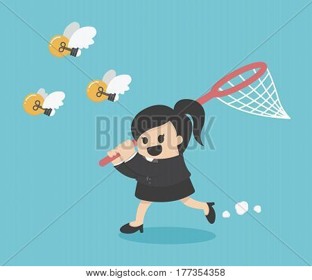 business woman try to catch flying idea bulb