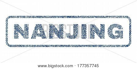 Nanjing text textile seal stamp watermark. Blue jeans fabric vectorized texture. Vector tag inside rounded rectangular shape. Rubber sticker with fiber textile structure.