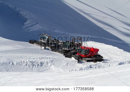 SOCHI, RUSSIA - MARCH 22, 2014: Ratraks, grooming machines, special snow vehicles.