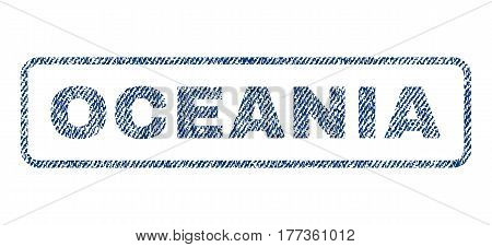 Oceania text textile seal stamp watermark. Blue jeans fabric vectorized texture. Vector tag inside rounded rectangular banner. Rubber emblem with fiber textile structure.