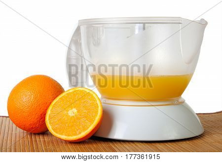 Still life with a juice extractor isolated on mat