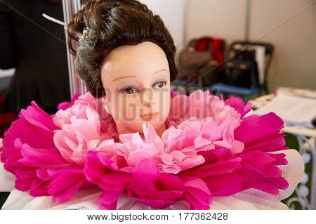 Head of a mannequin with a beautiful wedding hairstyle