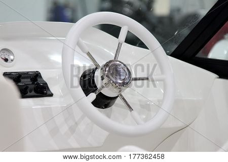 The dashboard and the steering wheel modern boats.
