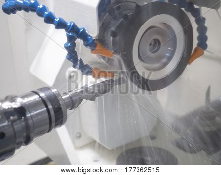 operator grinding cutting tool by CNC grinding machine poster