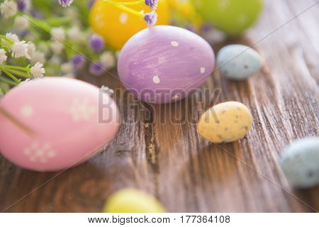 Easter Eggs And Spring Flower On Rustic Wooden Background.