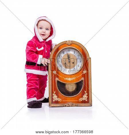 Cute Little Santa Posing Against White Background Near Clock